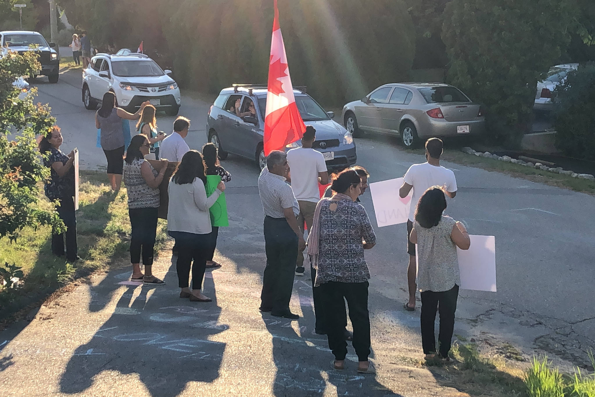 Hundreds of Summerland residents honked and waved in a show of support as they drove past the Lekhi family home on Hespeler Road on July 16. The home had been vandalized and racist graffiti had been spray painted on the walls on July 13. (John Arendt - Summerland Review)