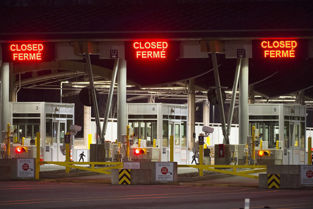 The Canadian border was pictured at the Peace Arch Canada/U.S.A. border crossing in Surrey back in March. The border remains closed for the most part. (Jonathan Hayward/Canadian Press)