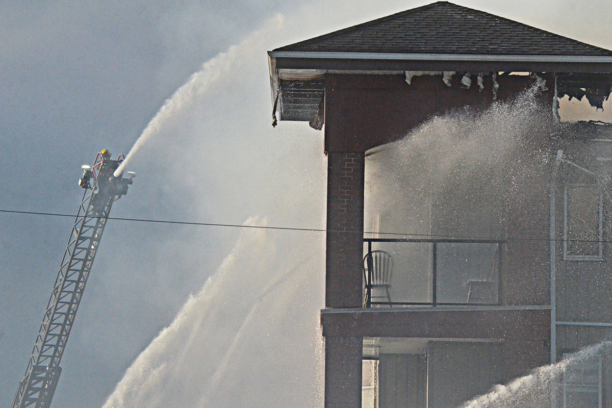 Fire seriously damaged a four-storey Langley City apartment building on Friday evening. (Matthew Claxton/Langley Advance Times)                                Fire seriously damaged a four-storey Langley City apartment building on Friday evening. (Matthew Claxton/Langley Advance Times)