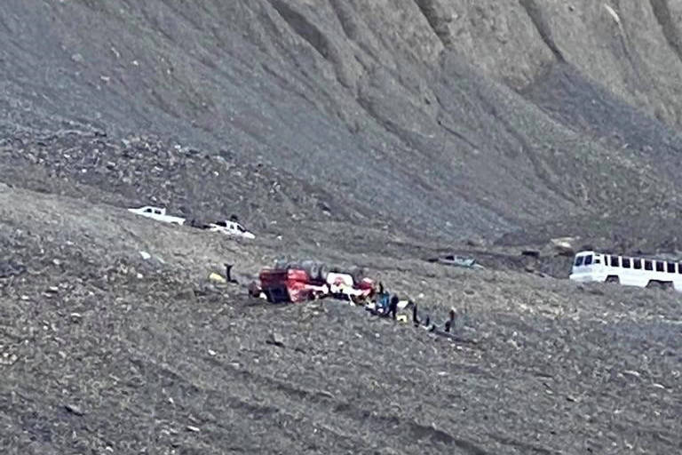 RCMP in Alberta say there are reports that multiple people are injured after a bus, similar to the vehicle pictured, rolled over on a highway that runs between Jasper and Banff National Parks. Responders attend to a rolled-over icefield touring bus in Jasper National Park, Alta., in a handout photo taken Saturday, July 18, 2020. THE CANADIAN PRESS/HO-Randy Cusack