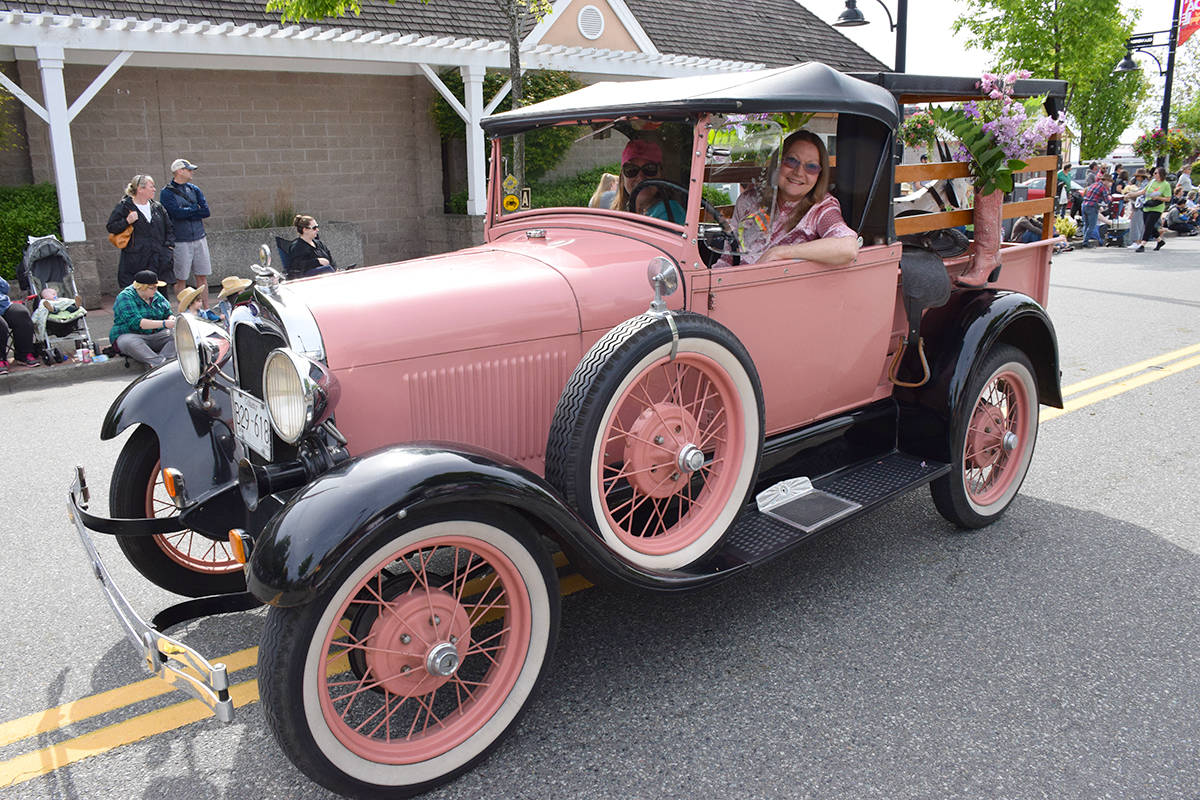 "BC Vintage Truck Museum president Anna Dean drives a classic truck called the ""Pink Lady."" Dean recently announced the truck museum would reopen to the public July 25. (Black Press Media file photo)"
