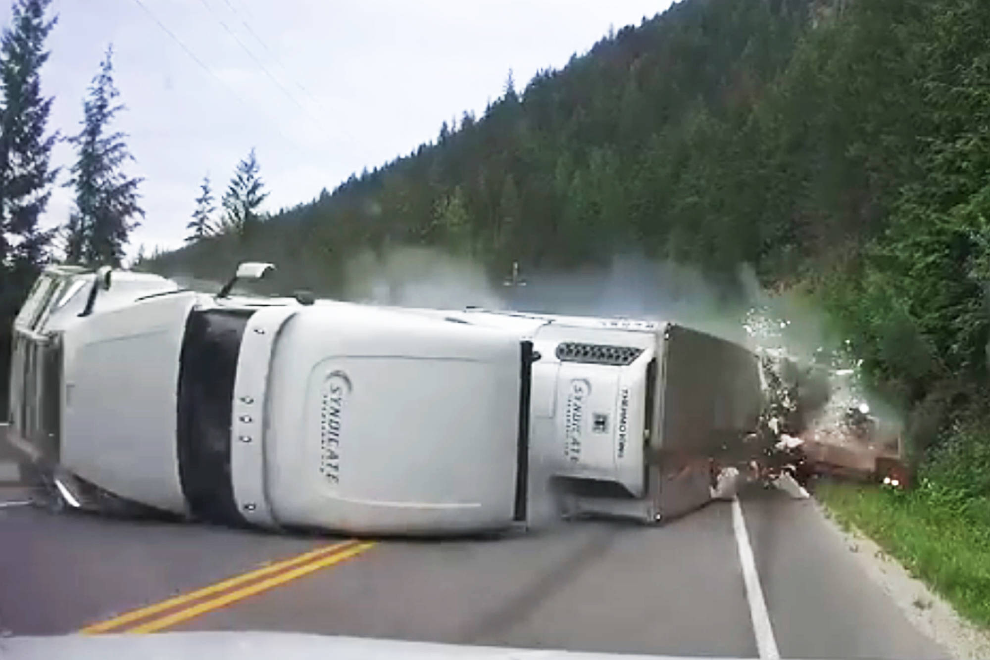 A still from Golden resident Chad Willox's dashcam footage shows a westbound semi and trailer colliding with a pickup truck before his own vehicle hit the trailer during a six-vehicle collision on Highway 1 west of Sicamous on Wednesday, July 15, 2020. (Chad Willox-Facebook image)