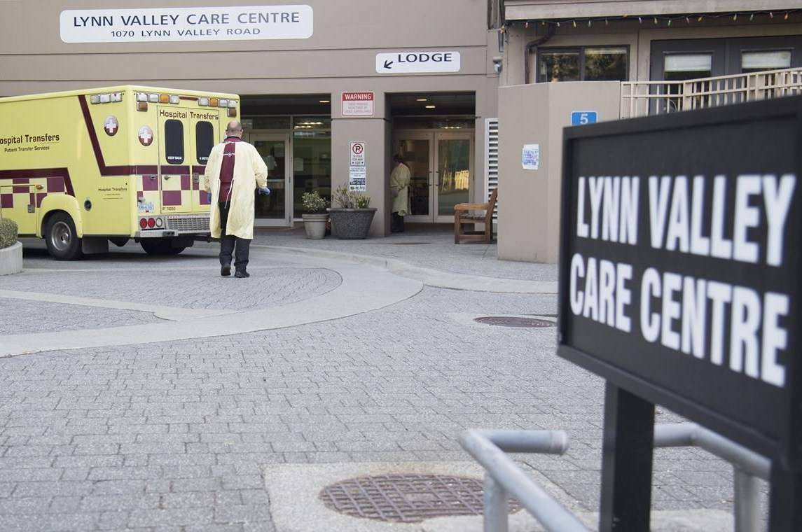 FILE – Hospital transfer workers are seen outside the Lynn Valley Centre care home in North Vancouver, B.C. on April 8, 2020. THE CANADIAN PRESS/Jonathan Hayward