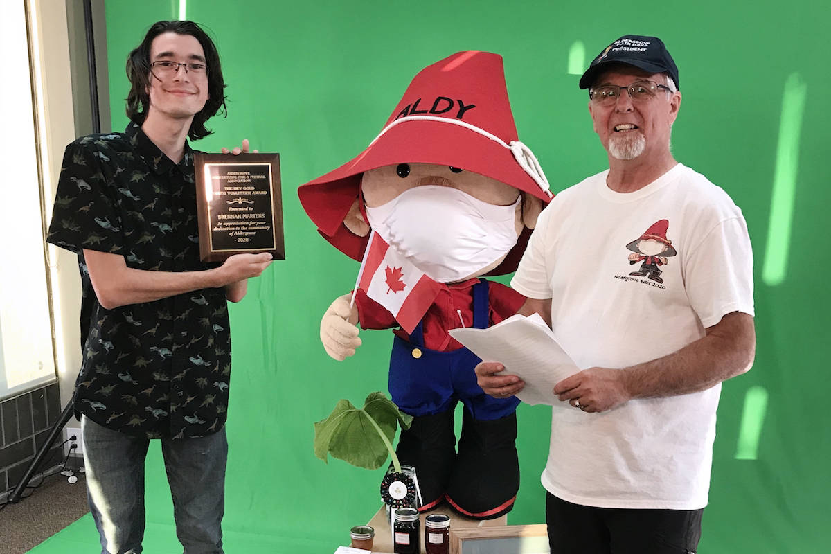 Recent ACSS graduate Brennan Martens (left) was awarded the Bev Gold youth volunteer award by fair president Robin McIntosh during the Aldergrove Fair's livestream on Saturday, July 18. (Aldergrove Fair/Special to the Star)