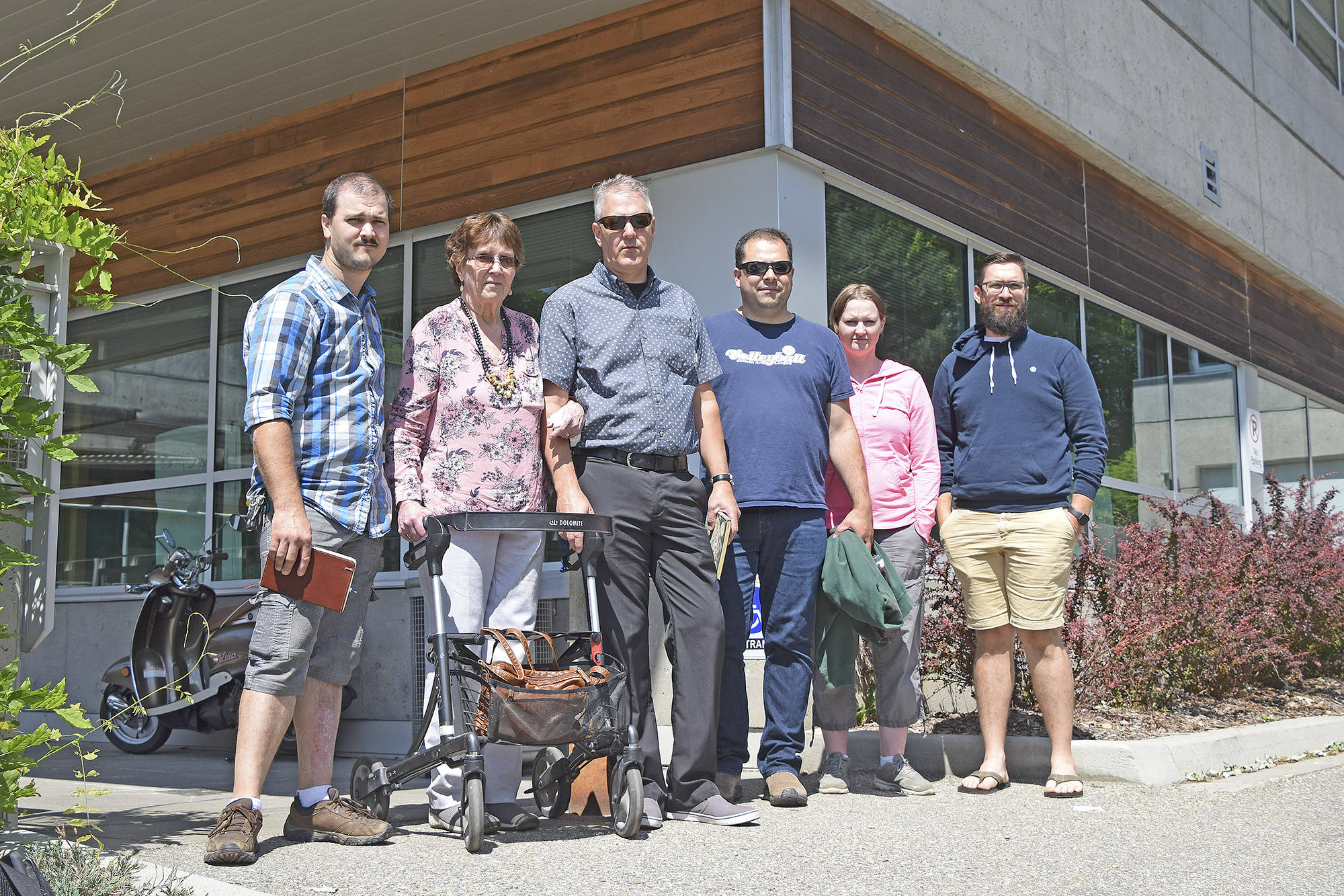 The Parmenter family stands outside the Salmon Arm Law Courts on Tuesday, July 22, 2020, while attending the murder trial of Matrix Gathergood who is facing a murder charge for the killing of Gordon Parmenter. From left, Gordon's grandson Jonathan, his spouse Peggy, his sons David and Tony, Tony's spouse and Gord's daughter-in-law Melissa, and Gord's grandson Lucas. (Martha Wickett - Salmon Arm Observer)