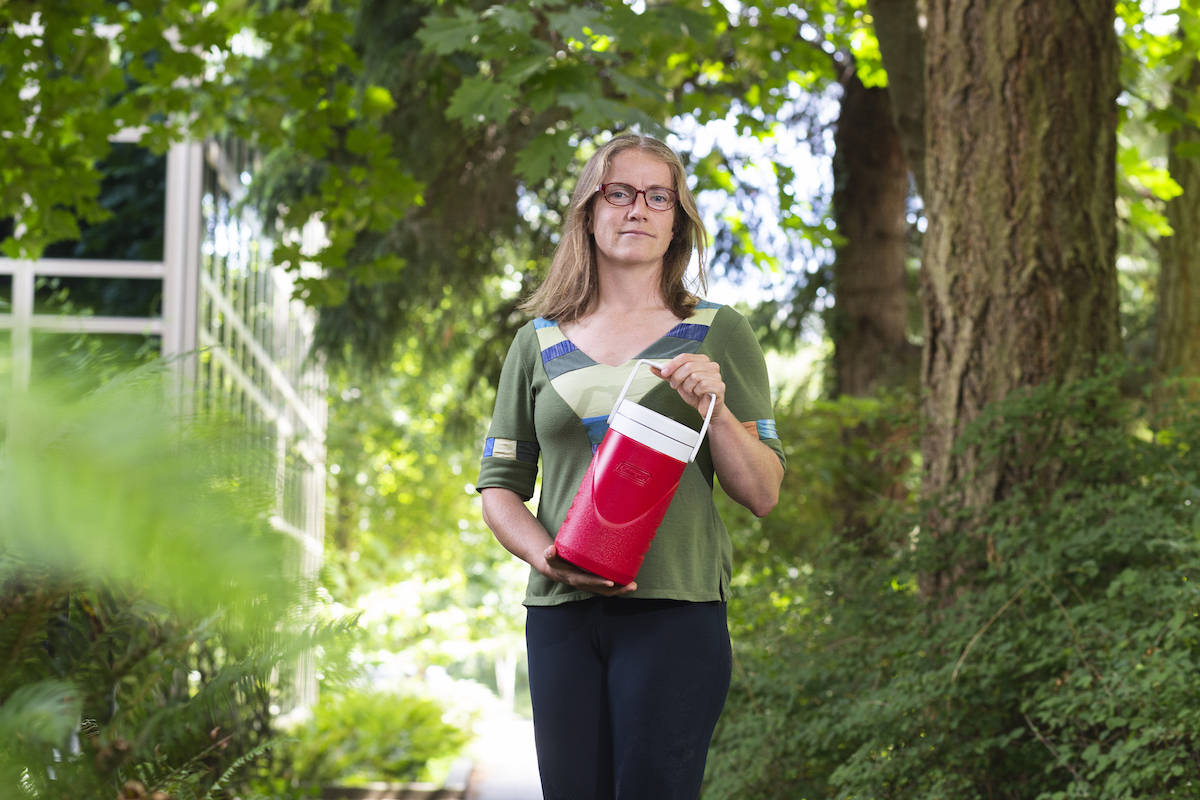 UVic researcher Heather Buckley holds a wastewater sample, which will be used to study and identify future outbreaks of COVID-19 throughout B.C., starting in Greater Victoria. (Courtesy of University of Victoria)