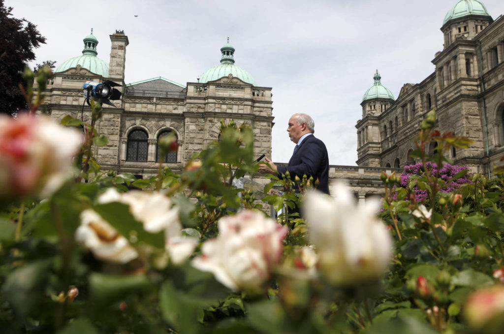 B.C. Premier John Horgan provides the latest update on the COVID-19 response in the province during a press conference from the rose garden at Legislature in Victoria, B.C., on Wednesday, June 3, 2020. THE CANADIAN PRESS/Chad Hipolito