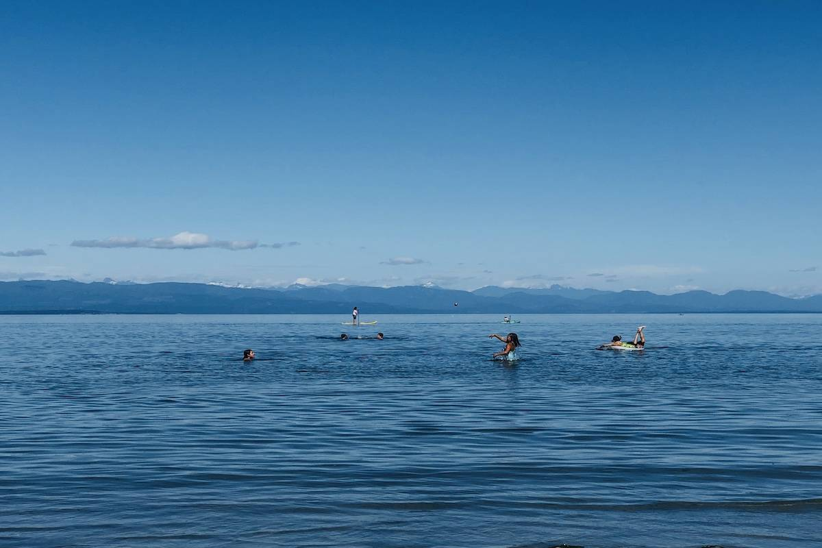 Residents enjoy water activities at Saratoga beach near Campbell River. Lifesaving Society, a non-profit that aims to reduce water-related deaths urges citizens to be cautious and mindful of safety measures. Photo by Binny Paul/Campbell River Mirror