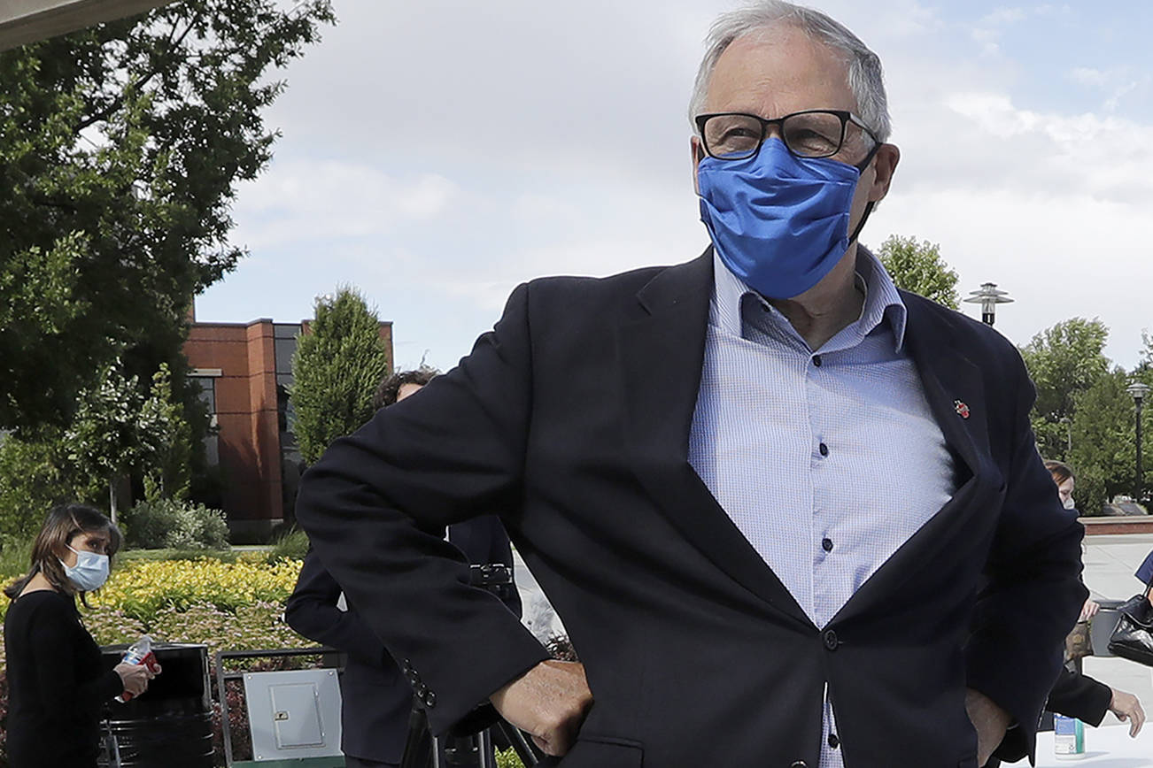 In this photo taken Tuesday, June 16, 2020, Washington state Gov. Jay Inslee talks about the coronavirus outbreak following a briefing at Yakima Valley College in Yakima, Wash. (AP Photo/Elaine Thompson)