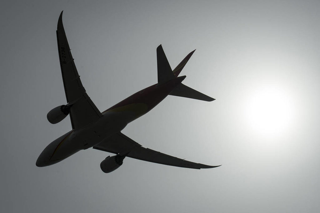 FILE – A plane is silhouetted as it takes off from Vancouver International Airport in Richmond, B.C., Monday, May 13, 2019. THE CANADIAN PRESS/Jonathan Hayward