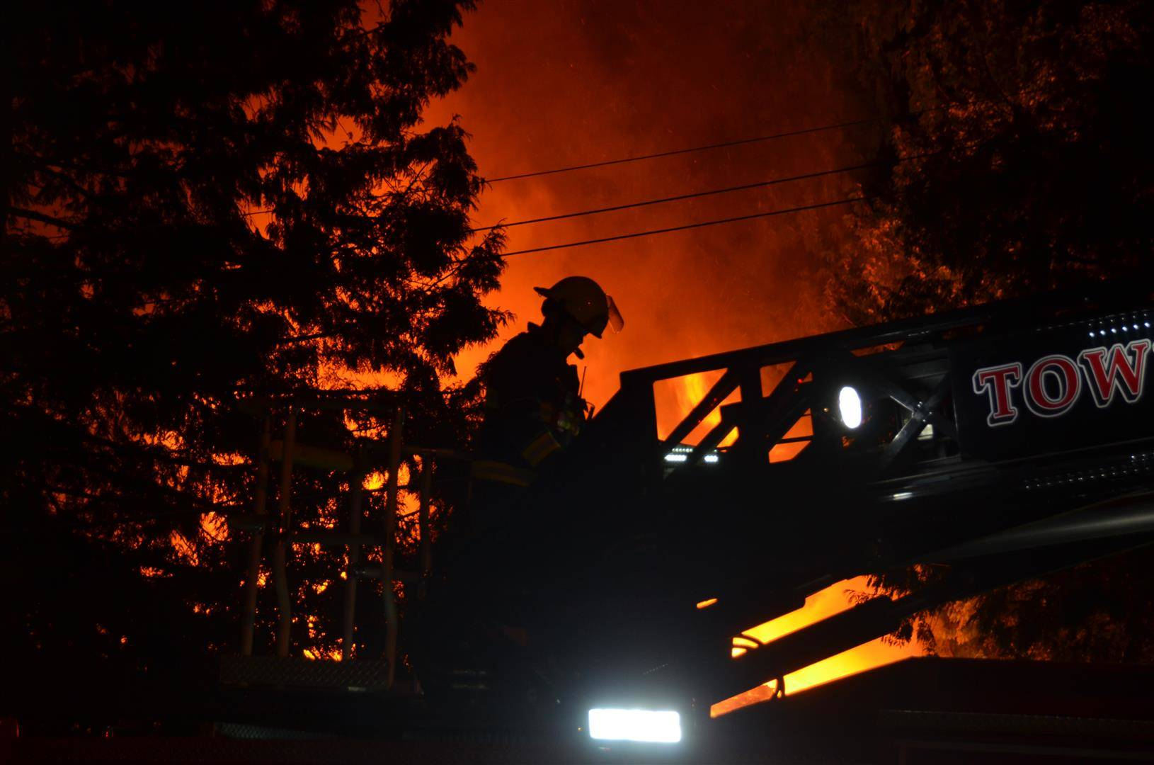 Township firefighters received multiple reports of a fire around 12:08 a.m. Monday, July 27, 2020 in the Yorkson neighbourhood. Crews arrived to a home at 20559 86 Ave. to find the blaze spread through multiple place in the home on the property. (Curtis Kreklau/Special to Langley Advance Times)