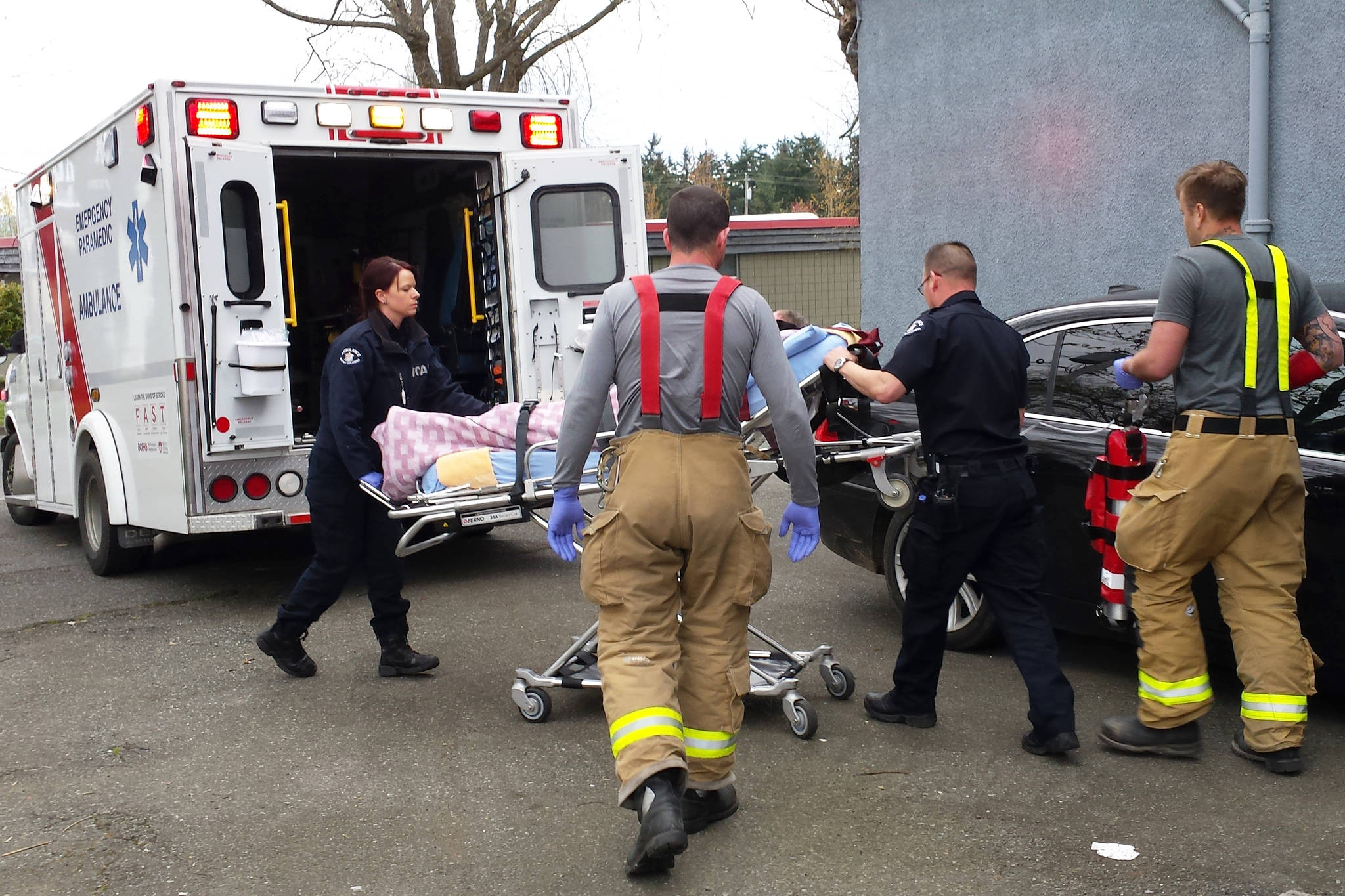 Dan Jack photo First responders prepare to transport an apparent overdose victim in downtown Parksville Saturday morning, April 22, 2017.