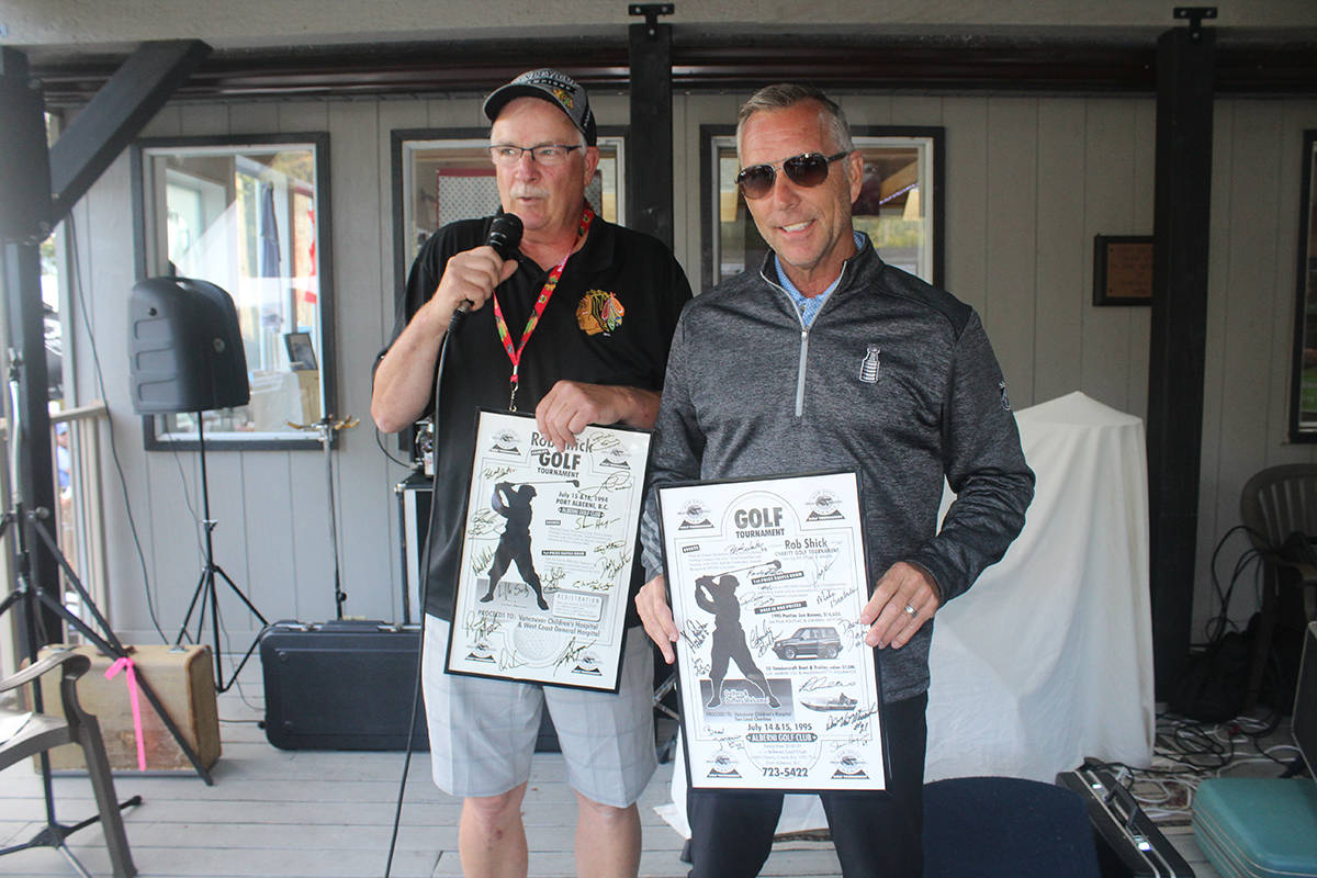 Tournament director Bruce MacDonald presents Rob Shick with framed copies of a poster from the first charity golf classic 25 years ago. SONJA DRINKWATER PHOTO