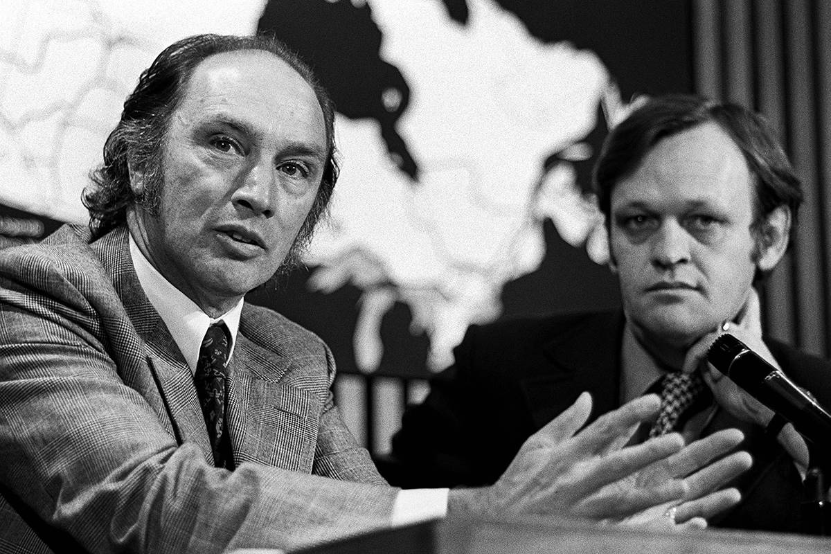 Prime Minister Pierre Trudeau speaks at a press conference in Ottawa on June 19, 1972. Beside him is Cabinet Minister Jean Chretien. THE CANADIAN PRESS/Peter Bregg