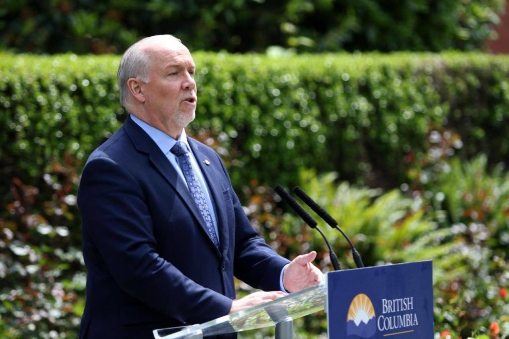 B.C. Premier John Horgan provides the latest update on the COVID-19 response in the province during a press conference from the rose garden at Legislature in Victoria, B.C., on Wednesday, June 3, 2020. Horgan says those who have offshore licence plates on their vehicles while driving in the province should take the bus or ride a bicycle if they're feeling harassed by the public. THE CANADIAN PRESS/Chad Hipolito