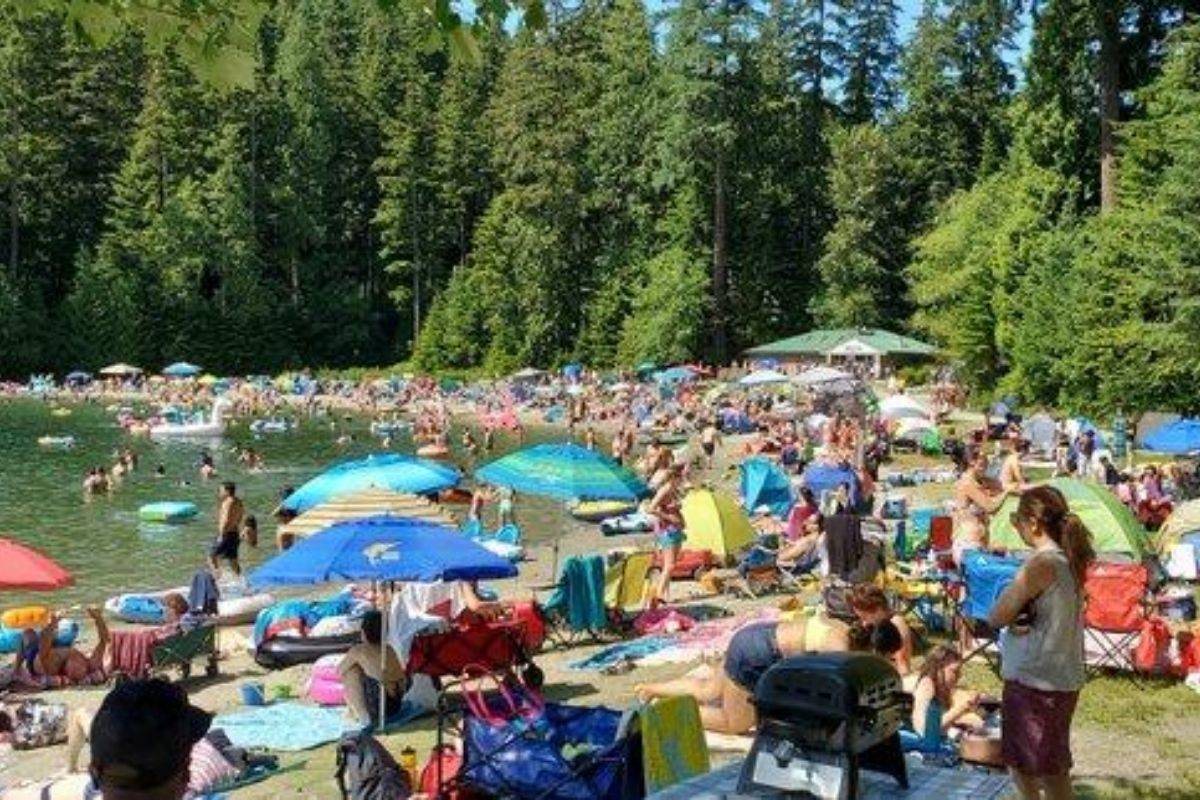 Lake Sasamat, pictured on Sunday, July 19, 2020, has seen an increase in beach-goers not respecting social distancing, and that has public officials in the area concerned. (igamband/Twitter)