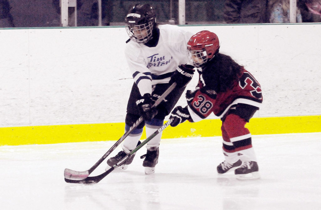 Skaters and hockey players like these Langley Girls Ice Hockey Association players might return to Langley Township arenas this year, but it won't be like pre-COVID. (Langley Advance Times files)