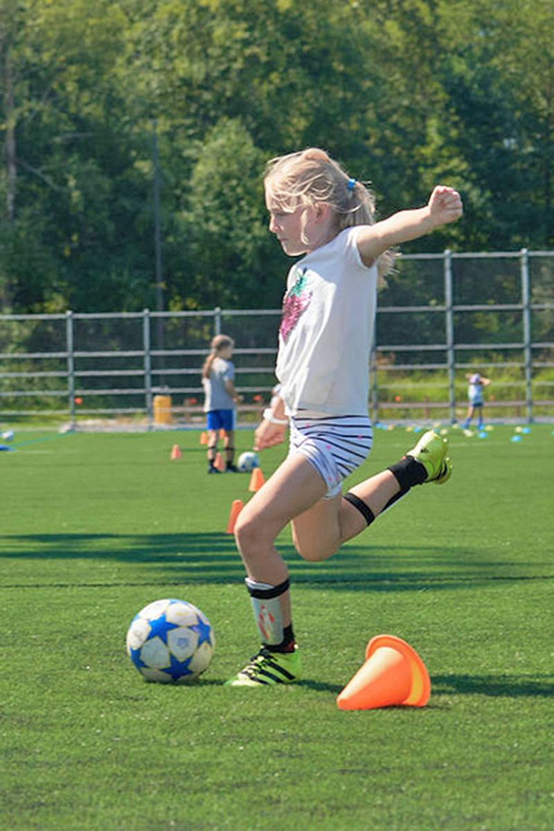 A young player winds up at a Langley United Soccer Association training session at Willoughby park (Courtesy Langley United)