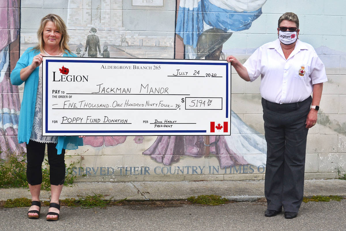 Jackman Manor's Denise Morin (left) accepted a $5,194 cheque from Aldergrove legion vice-president Karen Hobbis on Friday, July 24, for the Aldergrove assisted-living centre to purchase a mechanical overhead life to aid its palliative residents. (Sarah Grochowski/Aldergrove Star)