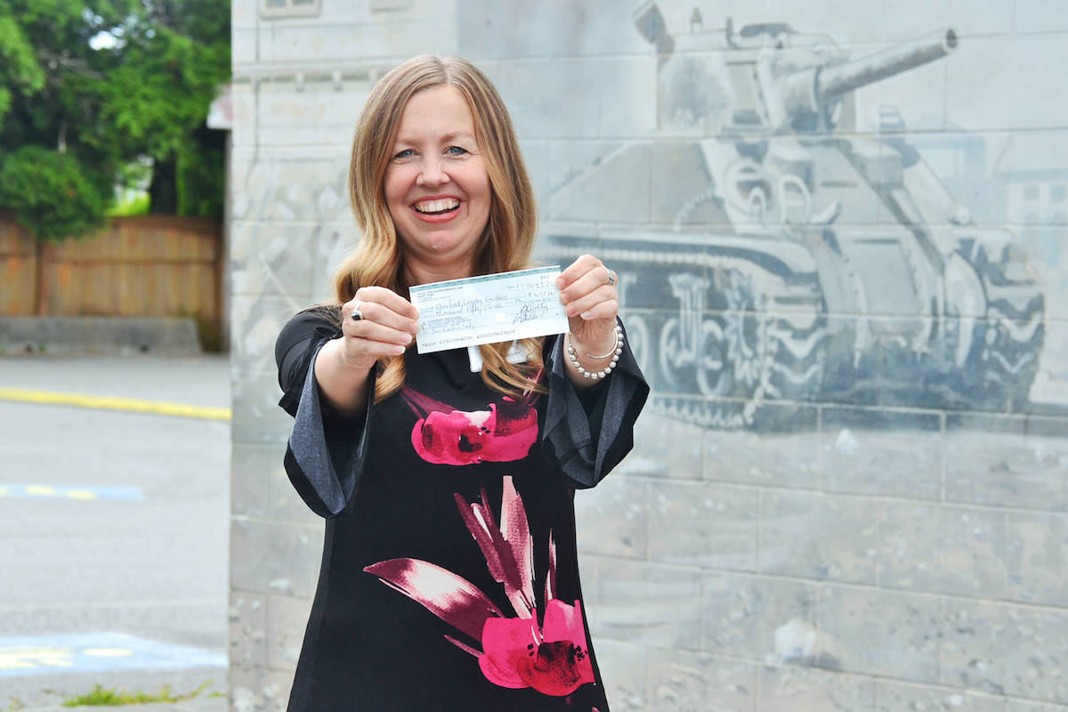 Director of sales Marie Lashely, of Chartwell Retirement Residences, accepted a $4,053 cheque from the Aldergrove legion Poppy Fund on Friday, July 24, to purchase two new electric beds for veterans at Chartwell Langley Gardens. (Sarah Grochowski/Aldergrove Star)