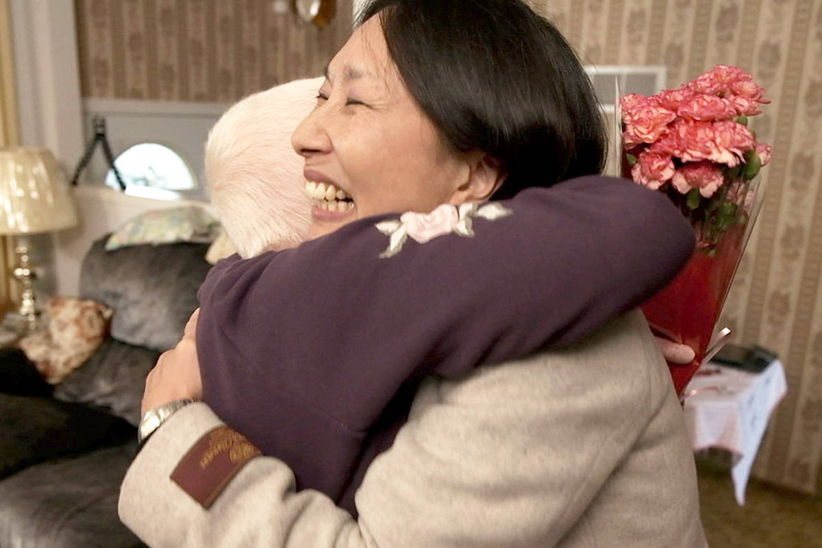 Heart recipient Carrie Yung embraces organ donor's mother, Marie Doherty, when they first meet after 17 years of correspondence. (BC Transplant photo)