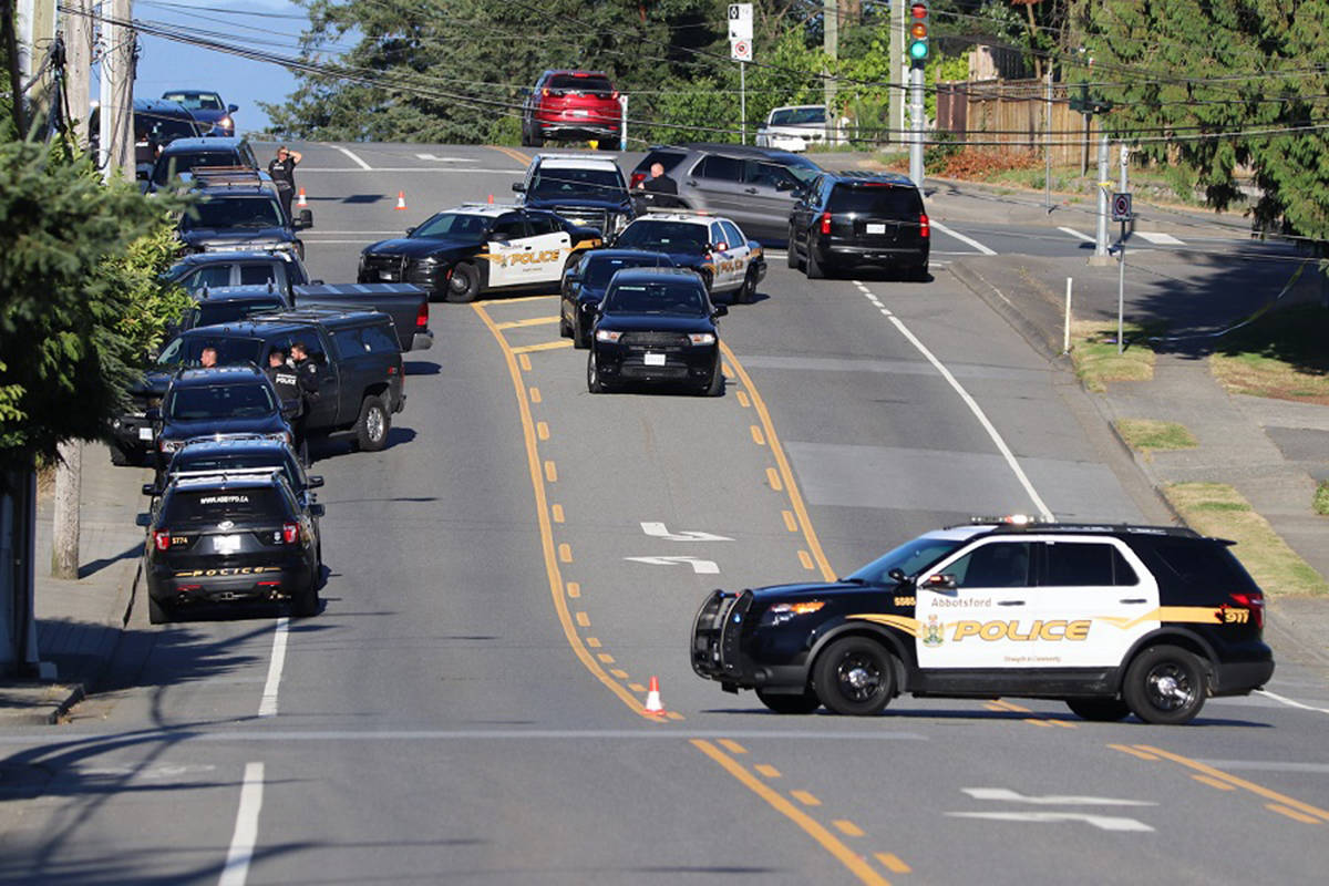 A large police presence, including Langley RCMP and Abbotsford Police, surrounded a home on Peardonville Road in Abbotsford on Saturday, July 25 following reports of an alleged parental child abduction. (Shane MacKichan/Special to Langley Advance Times)