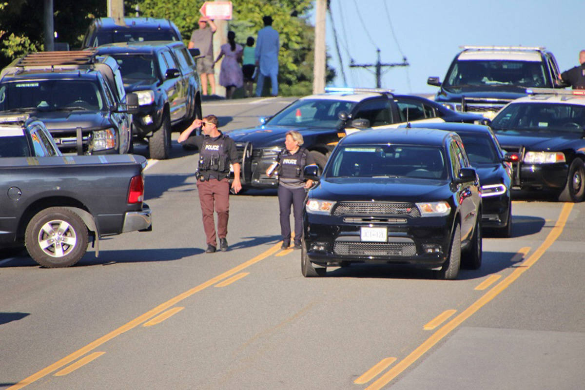 A large police presence, including Langley RCMP and Abbotsford Police, surrounded a home on Peardonville Road in Abbotsford on Saturday, July 25 following reports of an alleged parental child abduction. (Shane MacKichan photo)