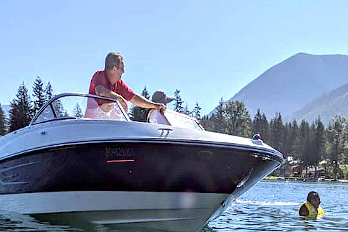 The motor boat that allegedly sideswiped a paddler at Cultus Lake's Main Beach on the morning of July 29, 2020. (Rick Joe/Facebook)