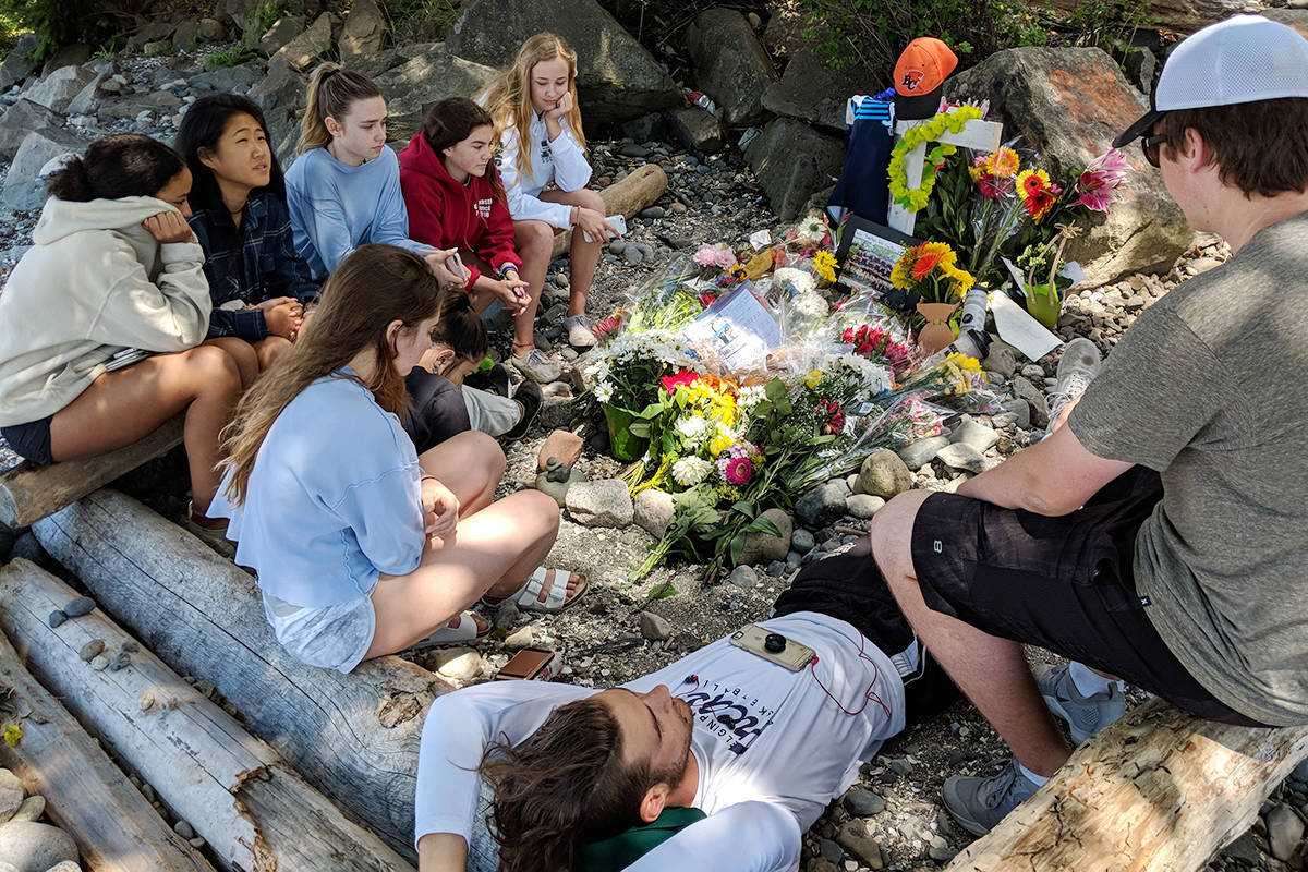 A group of high school students gather at a makeshift memorial for their friend, Jack Stroud, who was struck and killed by an Amtrak passenger train on July 4, 2018. (File photo)