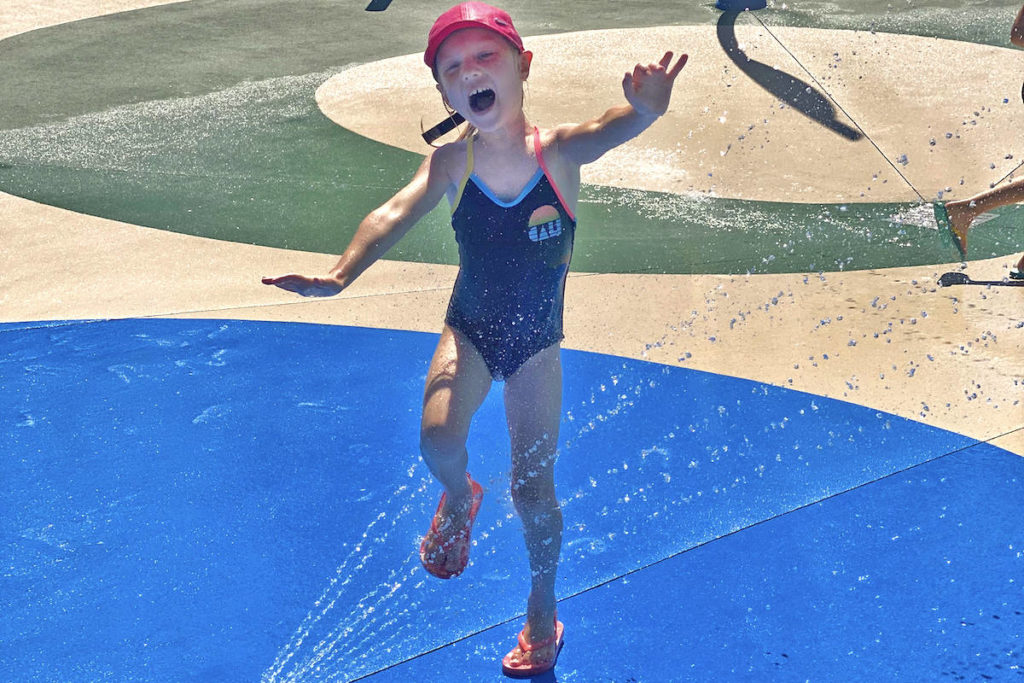 Seven-year-old Scarlet Peterson played in the Philip Jackman Splashpad on Monday, July 27. (Sarah Grochowski photo)