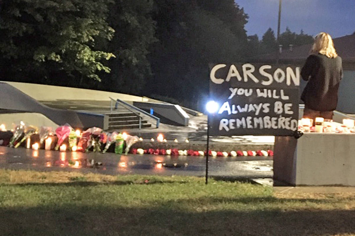 Family, friends and visitors lit candles and left flowers at the Walnut Grove skate park where Carson Crimeni used to hang out on Friday Aug. 7, 2020, the first anniversary of his death.(Darrel Crimeni/special to Langley Advance Times)