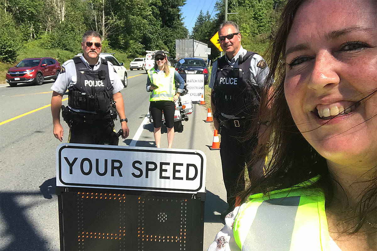 Langley's ICBC road safety group and local Mounties are out on local streets reminding drivers to slow down. They were recently set up at 16th Avenue and 200th Street. (Leanne Cassap/Special to Langley Advance Times)