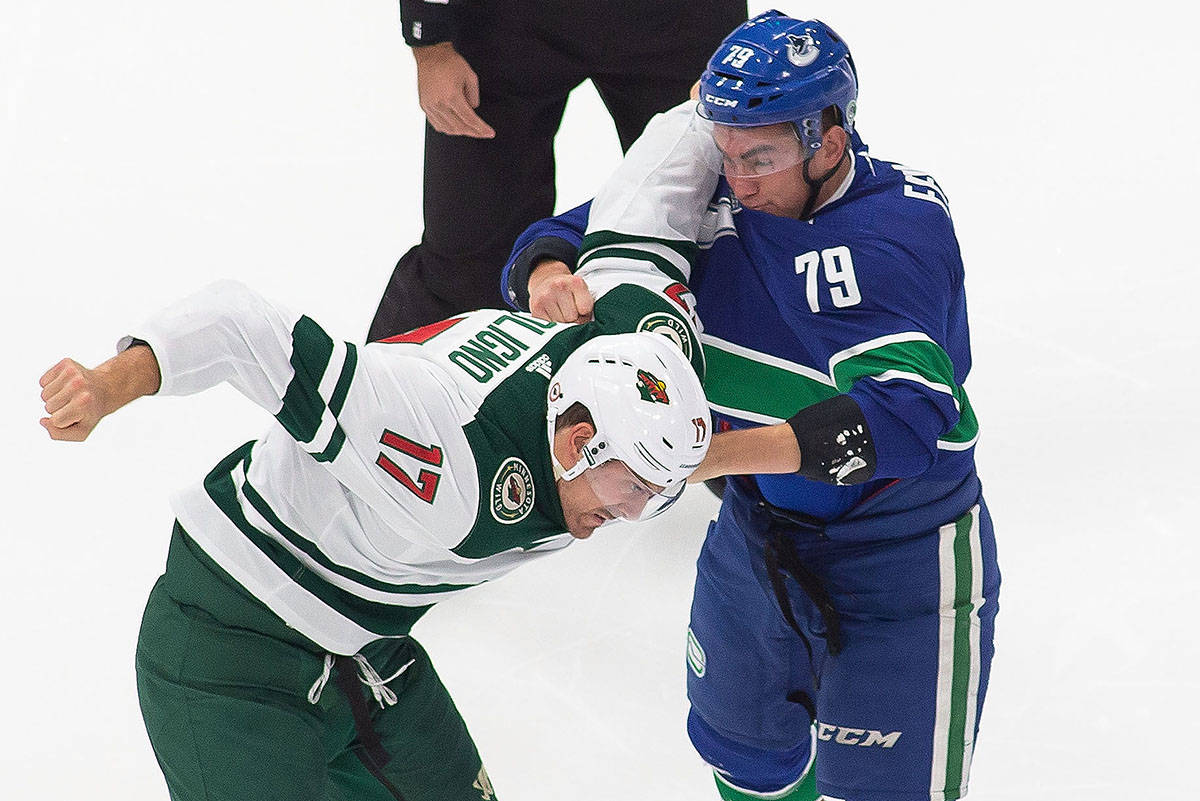 Vancouver Canucks' Micheal Ferland (79) fights Minnesota Wild's Marcus Foligno (17) during first period NHL Stanley Cup qualifying round action in Edmonton, Sunday, Aug. 2, 2020. THE CANADIAN PRESS/Codie McLachlan