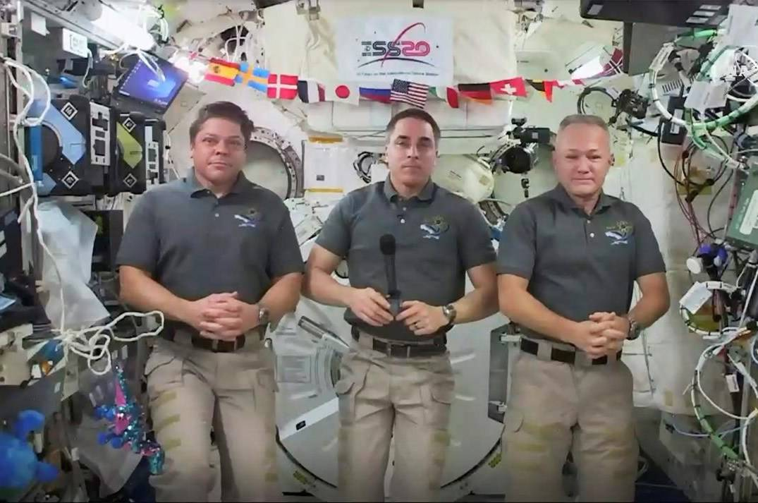 This photo provided by NASA shows from left, astronauts Bob Behnken, Chris Cassidy and Doug Hurley during an interview on the International Space Station on Friday, July 31, 2020. Behnken and Hurley are scheduled to leave the International Space Station in a SpaceX capsule on Saturday and splashdown off the coast of Florida on Sunday. (NASA via AP)