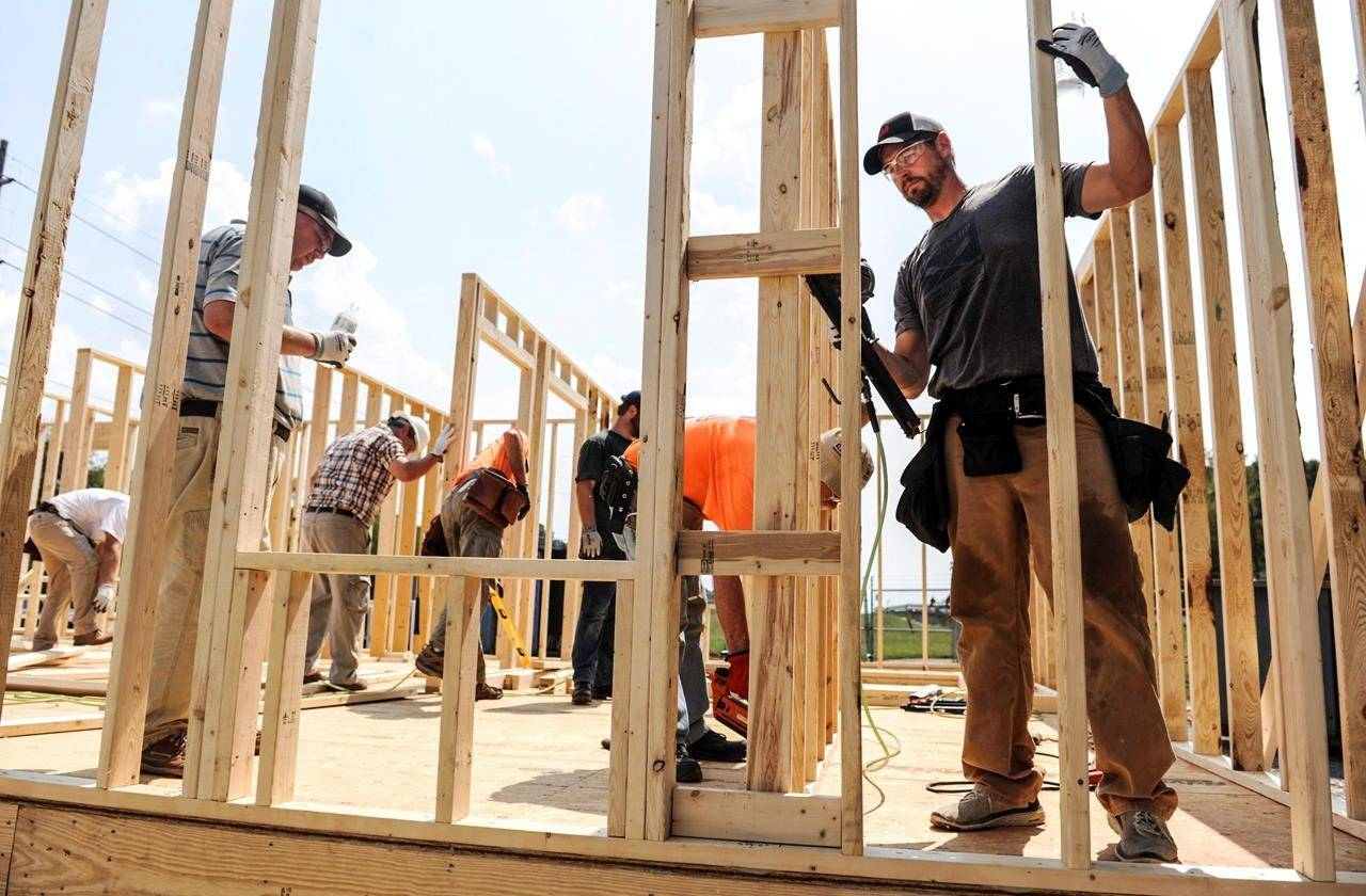 Workers build the frame of a Habitat for Humanity house as their United Way's Day of Caring project on Tuesday, Sept. 10, 2019, in Decatur, Ala. The head of a group that promotes charities says there are concerns about long-term negatives impacts in the sector from the ongoing WE controversy on Parliament Hill. THE CANADIAN PRESS/AP-Jeronimo Nisa/The Decatur Daily via AP)