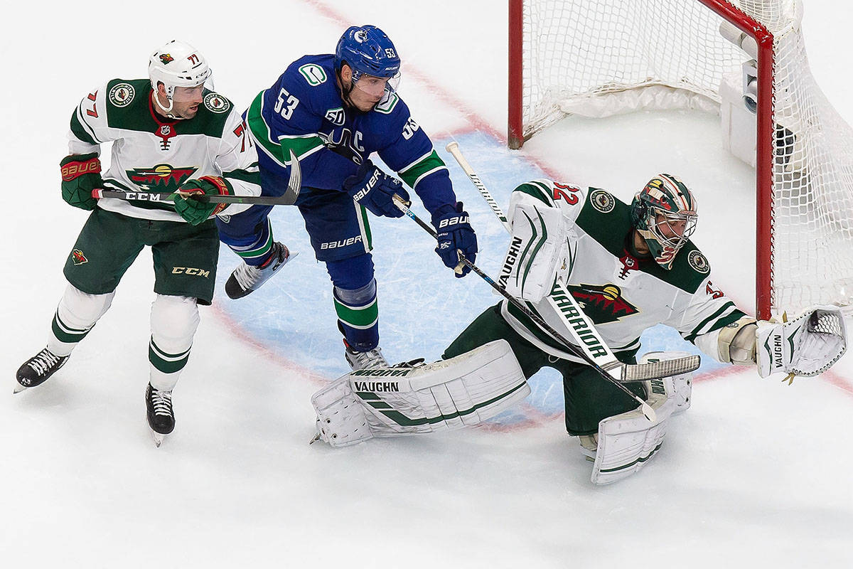 Minnesota Wild goaltender Alex Stalock (32) makes a save against Vancouver Canucks' Bo Horvat (53) as Wild's Brad Hunt (77) defends during second period NHL Stanley Cup qualifying round action in Edmonton, Tuesday, Aug. 4, 2020. THE CANADIAN PRESS/Codie McLachlan