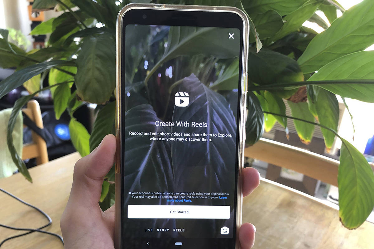 Instagram Reels is displayed on a mobile phone on Wednesday, Aug. 5, 2020 in New York. Facebook's Instagram is officially launching its answer to the hit short video app TikTok — Instagram Reels. The new Instagram feature will let users record and edit 15-second videos with audio, and will let users add visual effects. Users will be able to share Reels with followers in Instagram in a dedicated section called Reels in Explore, or in the Story feature where posts disappear after 24 hours. (AP Photo/Tali Arbel)