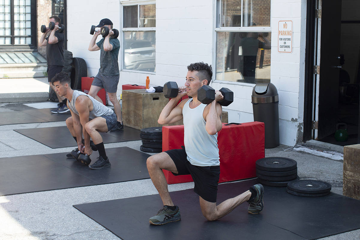 FILE – A fitness class takes place at Delta Train Liberty Village in Toronto, Friday, July 10, 2020. THE CANADIAN PRESS/Chris Young
