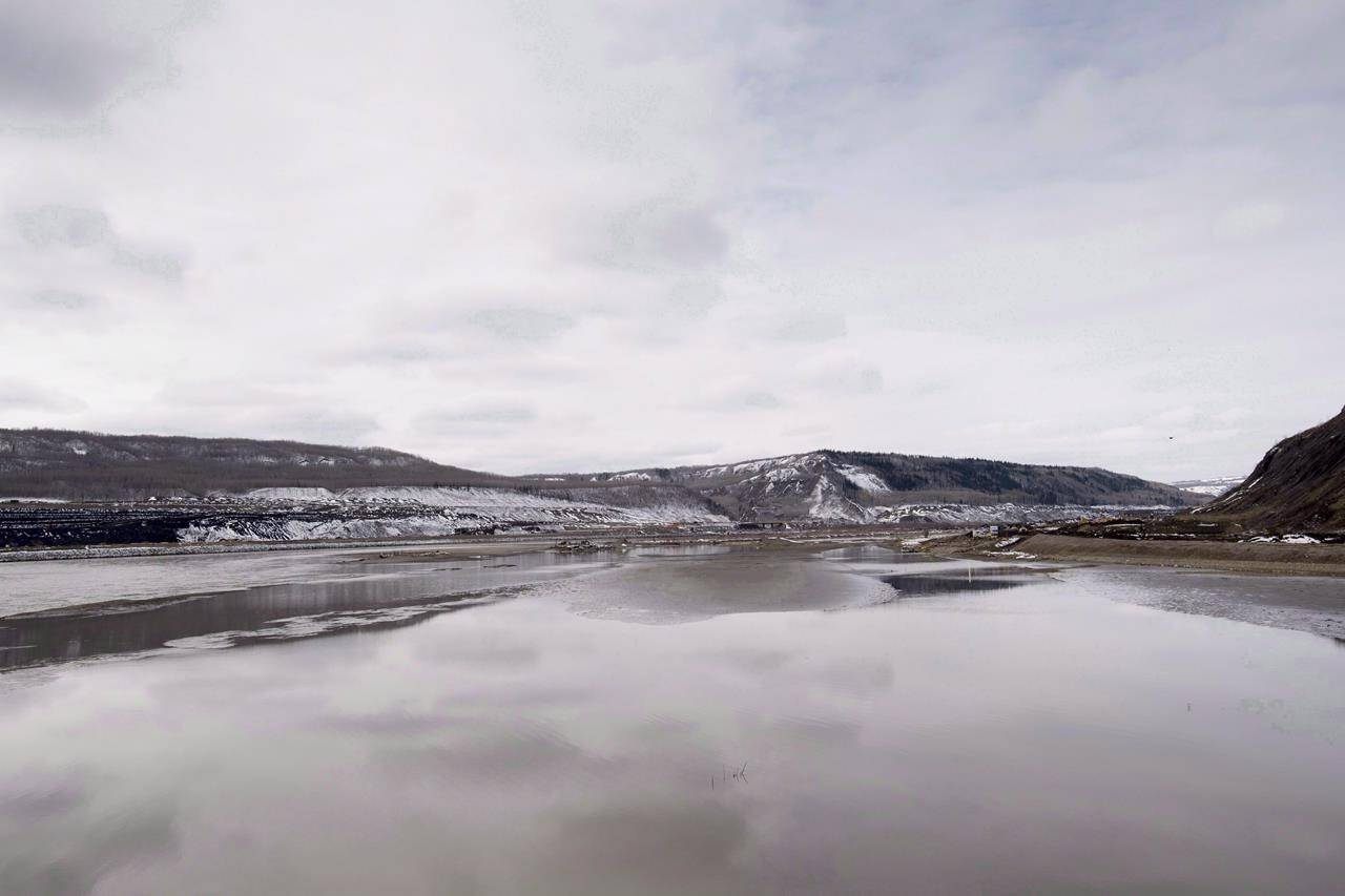 The Site C Dam location is seen along the Peace River in Fort St. John, B.C., Tuesday, April 18, 2017. The Prophet River First Nation, B.C. government and BC Hydro have reached an agreement ending a civil suit launched by the First Nation. THE CANADIAN PRESS/Jonathan Hayward