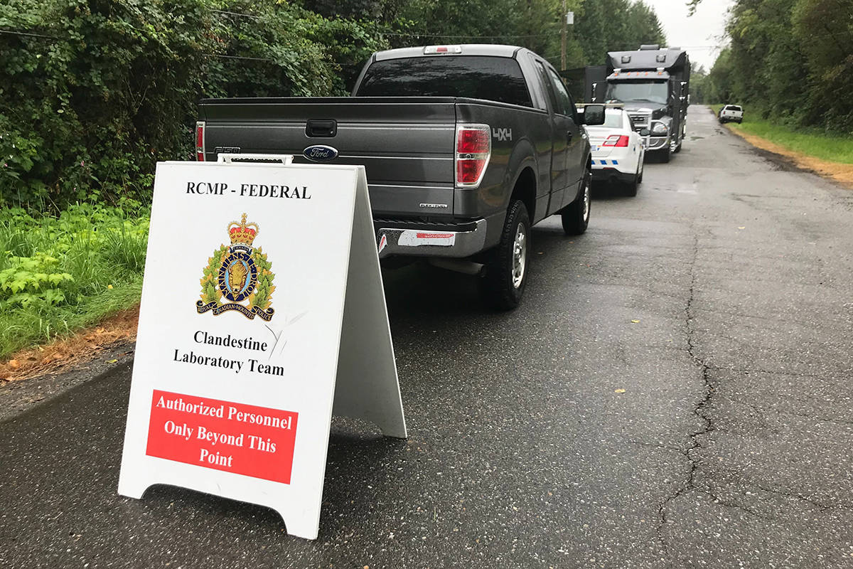 Ambulances, marked and unmarked RCMP vehicles are on scene in the area of 24800-block of 21B Ave Thursday, August 6, 2020 to dismantle a clandestine lab. (Matthew Claxton/Langley Advance Times)