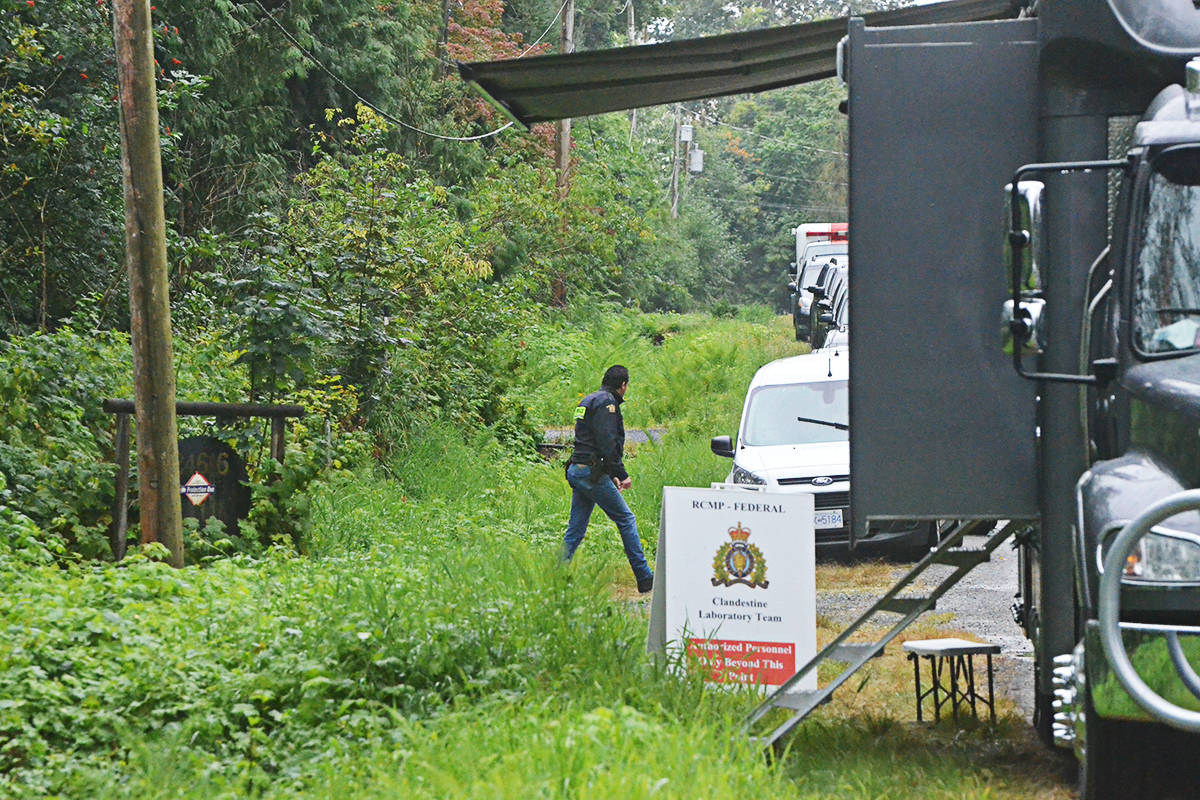 An RCMP officer leaves the property under investigation by the Clandestine Lab Team on Thursday, Aug. 6. (Matthew Claxton/Langley Advance Times)