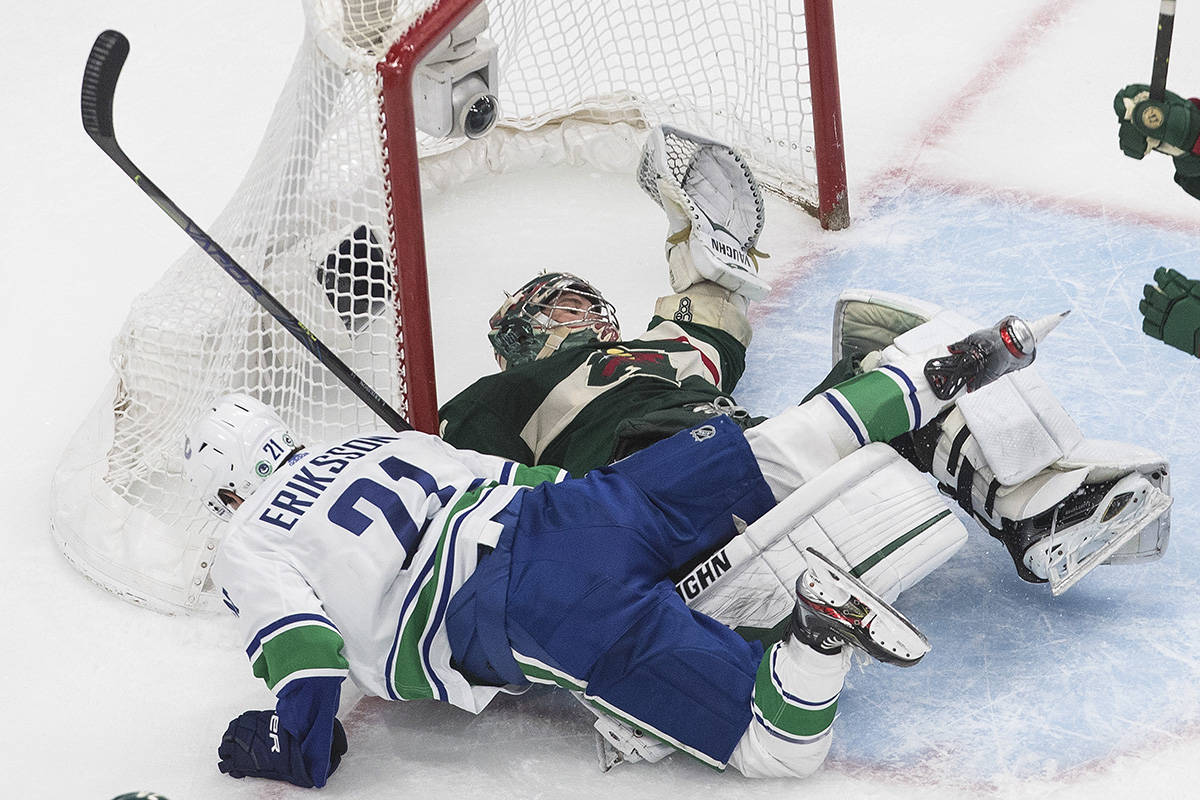 Minnesota Wild goalie Alex Stalock (32) is crashed into by Vancouver Canucks' Loui Eriksson (21) during second period NHL qualifying round game action in Edmonton on Thursday, August 6, 2020. THE CANADIAN PRESS/Jason Franson