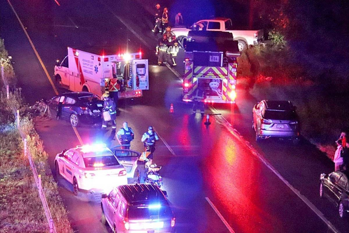 Police, fire and ambulance personnel respond to Highway 99 in South Surrey Thursday (Aug. 6) night, following reports of a wrong-way driver in the southbound lanes. (Shane MacKichan photo)