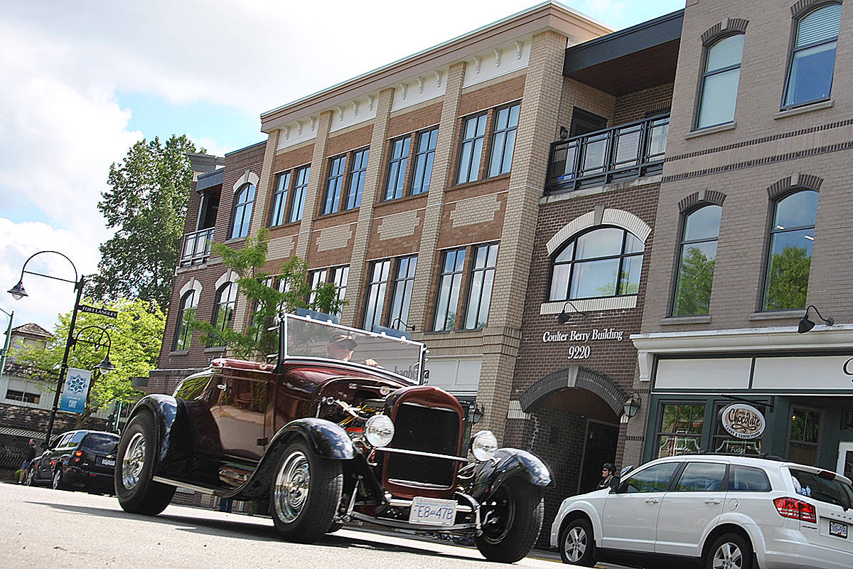 """Unlike the slow moving parade of vehicles that drove through Fort Langley during an unofficial May Day parade in mid-May (above), the village has since become a drag strip for too many """"irresponsible drivers,"""" endangering responsible motorists, cyclists, and pedestrians. (Langley Advance Times files)"""