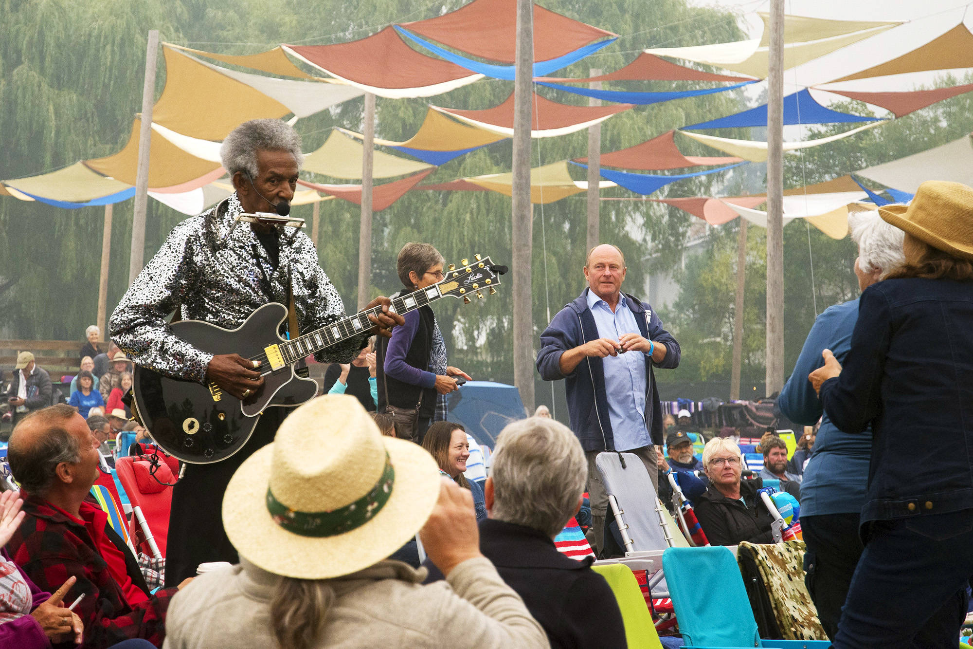 Lil Jimmy Reed keeps up the tune on guitar and harmonica after climbing down from the Roots & Blues main stage to walk amongst the crowd during the 2018 festival. Reed will be one of the performers featured in the online 2020 festival's first night. (Jim Elliot/Salmon Arm Observer)