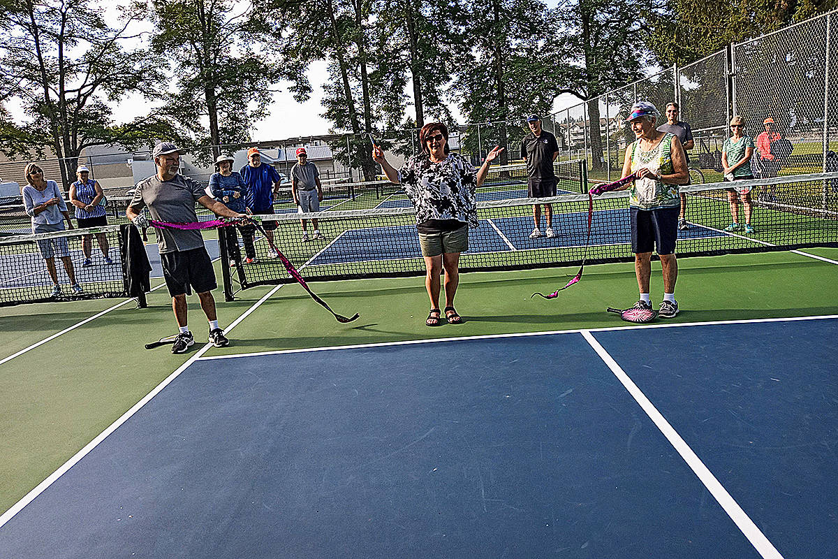 Langley City Mayor Val van den Broek officially opened the new pickleball courts at Douglas Park on Monday, Aug. 10. (Special to Langley Advance Times)