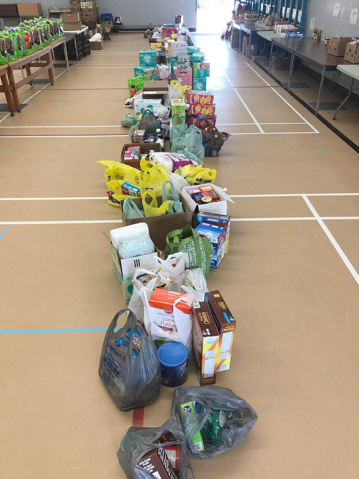 An Aug. 10 donation drive for the Doublas Park Community School Mobile Food Bank brought forth a lot of donations that will go to chidlren and families in the City. (Douglas Park Community School Facebook photo)