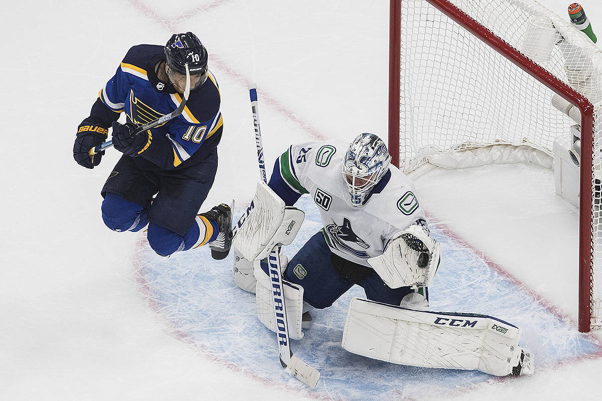 Vancouver Canucks goalie Jacob Markstrom (25) makes the save as St. Louis Blues' Brayden Schenn (10) jumps during the second period of a first round NHL Stanley Cup playoff hockey series in Edmonton, on Wednesday August 12, 2020. THE CANADIAN PRESS/Jason Franson
