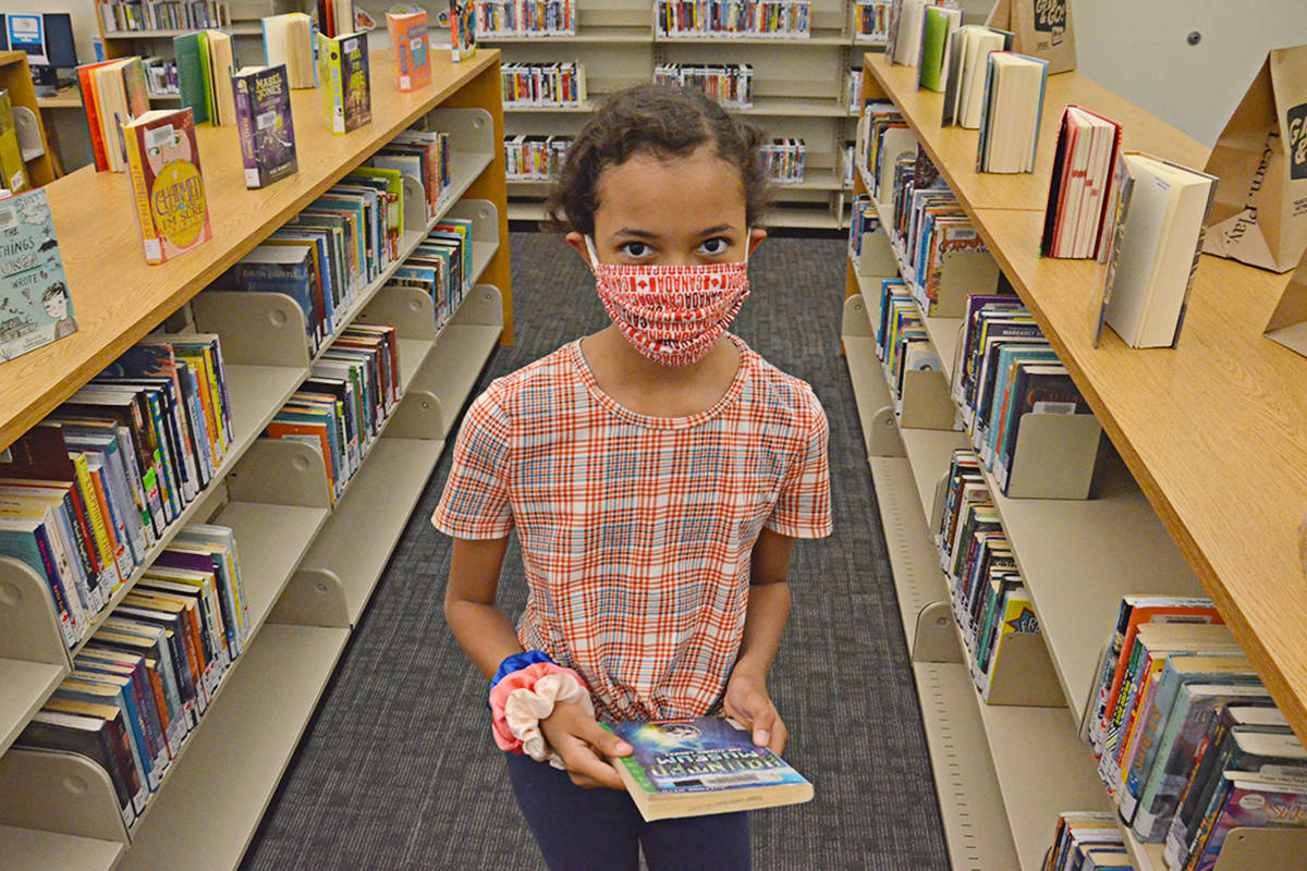 Latika Higgins, nine, missed being able to pick out books to read when the local library branches were closed. They re-opened Aug. 4. (Heather Colpitts/Langley Advance Times)