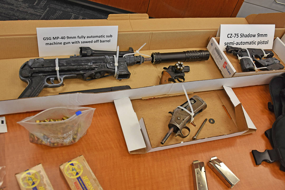A fully automatic firearm, pistol, makeshift silencer and body armour were seized. (Neil Corbett/The News)